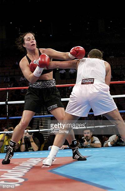 Lisa Holewyne evades a low blow by Christy Martin during the women's pound for pound championship fight at the Mandalay Bay Resort Casino in Las...