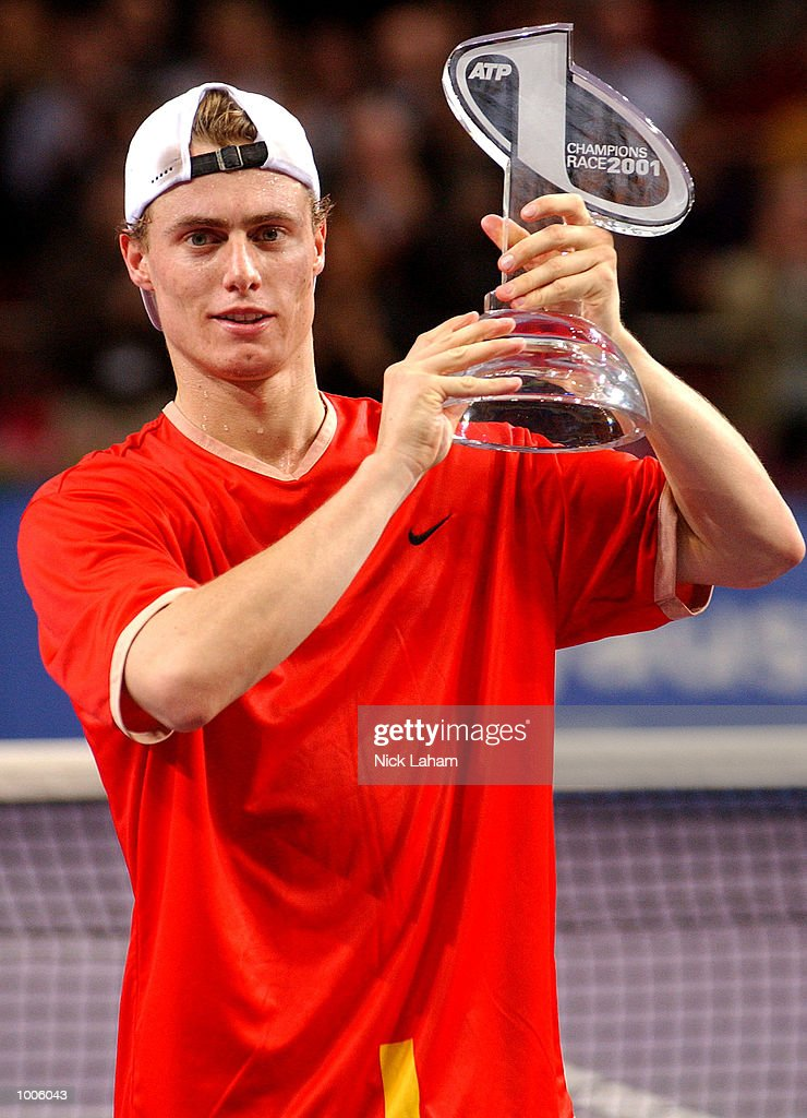 Lleyton Hewitt of Australia celebrates becoming the ATP world number one during the Tennis Masters Cup held at the Sydney Superdome, Sydney, Australia. DIGITAL IMAGE Mandatory Credit: Nick Laham/ALLSPORT