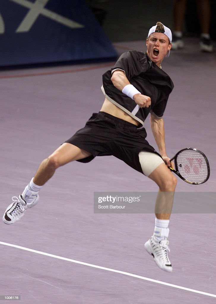 Lleyton Hewitt of Australia celebrates his victory during his semi final match against Juan Carlos Ferrero of Spain at the Tennis Masters Cup held at the Sydney Superdome in Sydney, Australia. DIGITAL IMAGE. Mandatory Credit: Scott Barbour/ALLSPORT