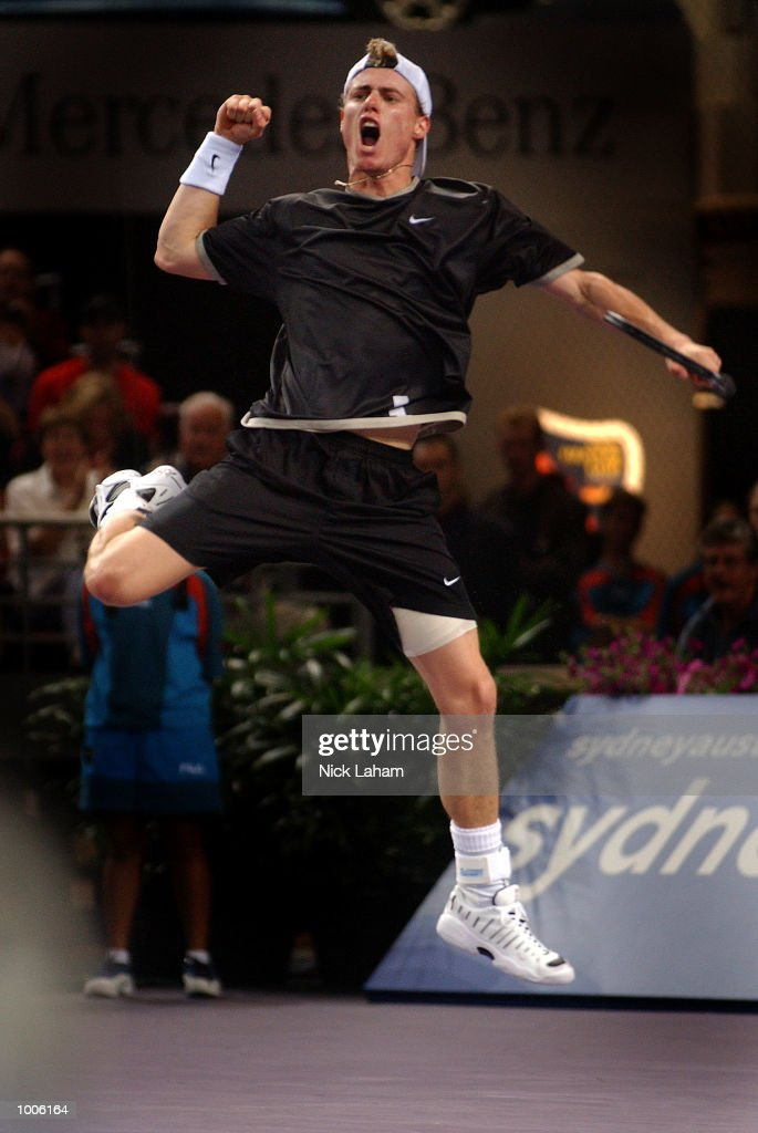 Lleyton Hewitt of Australia celebrates his victory over Juan Carlos Ferrero of Spain during the second semi final at the Tennis Masters Cup held at the Sydney Superdome, Sydney, Australia. DIGITAL IMAGE Mandatory Credit: Nick Laham/ALLSPORT