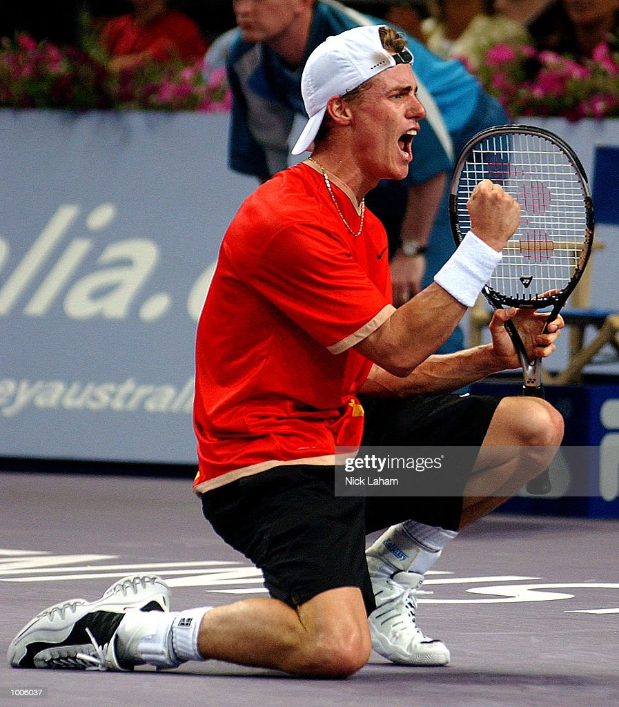 Lleyton Hewitt of Australia celebrates his victory over Patrick Rafter of Australia and capturing the ATP world number one ranking during the Tennis Masters Cup held at the Sydney Superdome, Sydney, Australia. DIGITAL IMAGE Mandatory Credit: Nick Laham/ALLSPORT