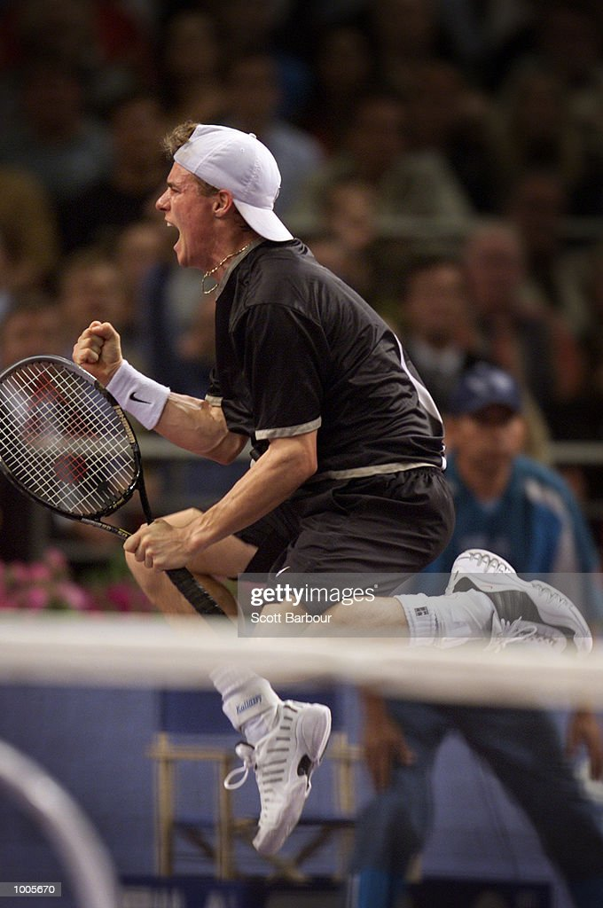 Lleyton Hewitt of Australia celebrates victory after his match against Andre Agassi of USA during day three of the Tennis Masters Cup held at the Sydney Superdome in Sydney, Australia. DIGITAL IMAGE. Mandatory Credit: Scott Barbour/ALLSPORT