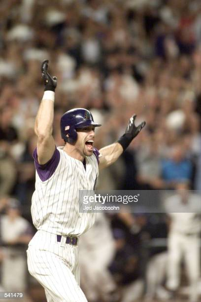 Luis Gonzalez of the Arizona Diamondbacks celebrates on his way to first base after scoring the winning run against the New York Yankees in the ninth...