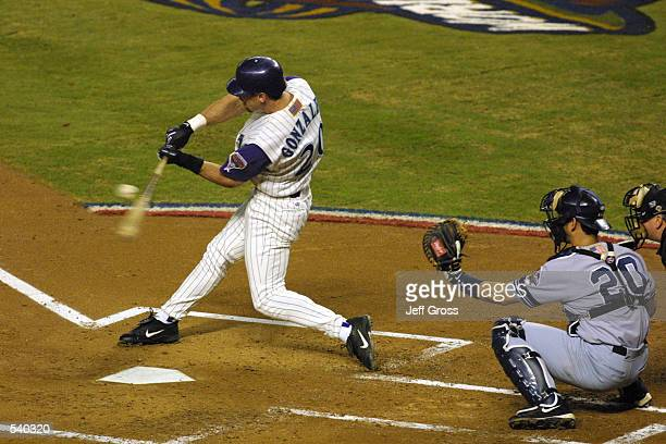Luis Gonzalez of the Arizona Diamondbacks swings at a pitch during game 6 of the World Series against the New York Yankees at Bank One Ballpark in...