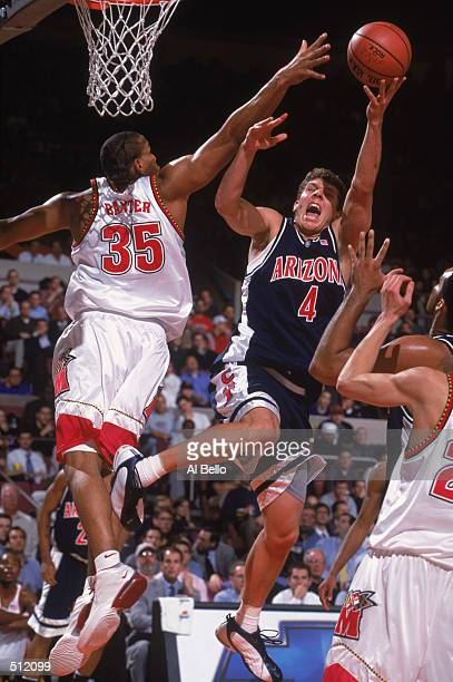 Luke Walton of the Arizona Wildcats leaps for the basket as he is blocked by Lonny Baxter of the Maryland Terrapins during the Coaches versus Cancer...