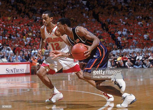 Luther Head of the Illinois Fighting Illini dribbles to the key as he is guarded by Drew Nicholas of the Maryland Terrapins during the game at Cole...