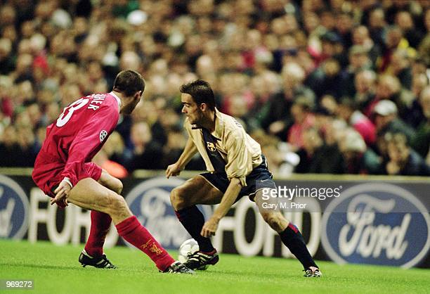 Marc Overmars of Barcelona takes on Jamie Carragher of Liverpool during the UEFA Champions League Group B match played at Anfield in Liverpool...