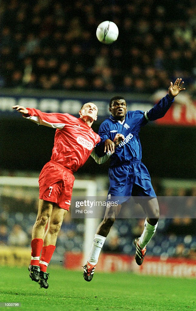 Marcel Desailly of Chelsea is challenged for the ball in the air by Milan Osterc of Tel-Aviv during the UEFA Cup 2nd round, 2nd leg match between Chelsea FC and Hapoel Tel-Aviv at Stamford Bridge, London. Mandatory Credit: Phil Cole/ALLSPORT