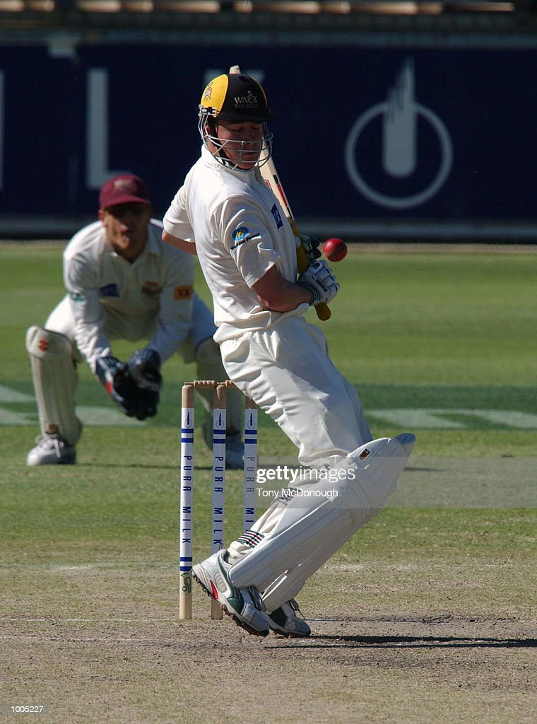 Marcus North of Western Australia defends his wicket against a bouncer from Mitchell Johnson of Queensland during Day 4 of the Pura Cup match between the Western Warriors and the Queensland Bulls at the WACA ground in Perth, Australia. DIGITAL IMAGE Mandatory Credit: Tony McDonough/ALLSPORT Mandatory Credit: Tony McDonough/ALLSPORT