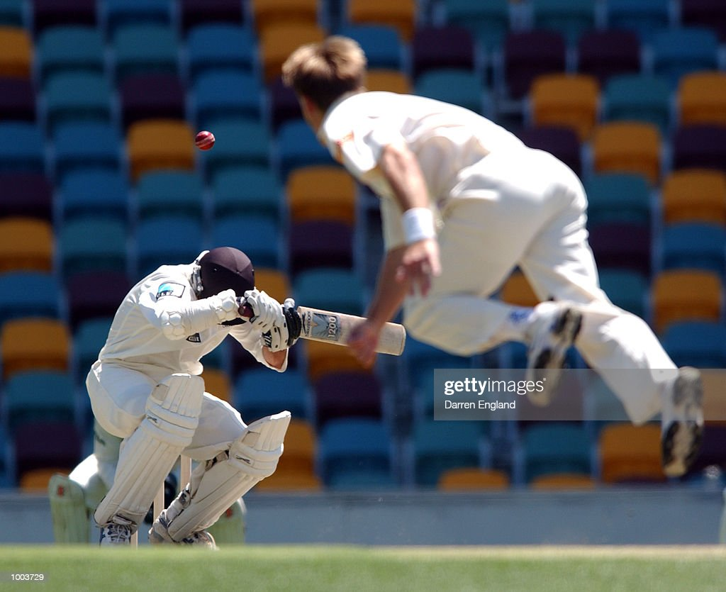 Mark Richardson of New Zealand ducks under a bouncer bowled by Andy Bichel of Queensland during the New Zealand cricket teams tour match against Queensland played at the Gabba in Brisbane, Australia. DIGITAL IMAGE. Mandatory Credit: DarrenEngland/ALLSPORT