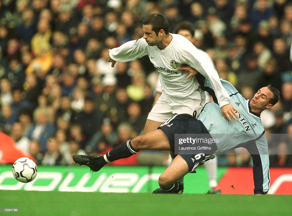 Mark Viduka of Leeds holds off Chris Perry of Spurs duing the match between Leeds United and Tottenham Hotspur in the FA Barclaycard Premiership at Elland Road, Leeds. Mandatory Credit: Laurence Griffiths/ALLSPORT