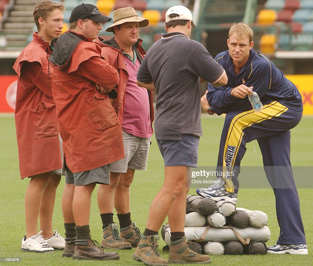 Matthew Hayden of Australia speaks to Gabba ground staff while waiting for rain to clear during day three of the first cricket test between Australia and New Zealand held at the Gabba, Brisbane, Australia, DIGITAL IMAGE Mandatory Credit: Chris McGrath/ALLSPORT