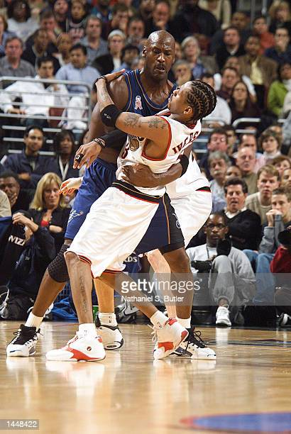 Michael Jordan of the Washington Wizards and Allen Iverson of the Philadelphia 76ers meet the at First Union Center in Philadelphia Pennsylvania...