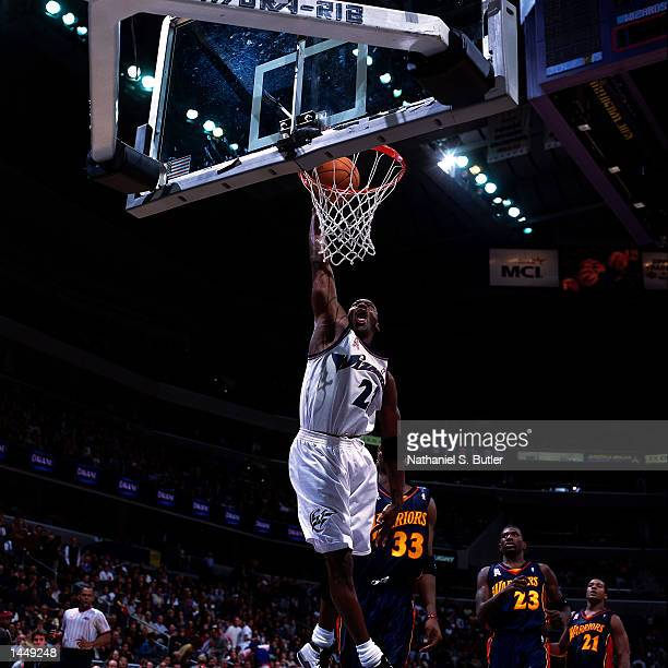 Michael Jordan of the Washington Wizards dunks against the Golden State Warriors during the NBA game at the MCI Center in Washington DC HIGH...