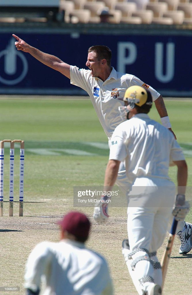 Michael Kasprowicz of Queensland claims the valuable wicket of Simon Katich, captain for Western Australia for 38 during Day 4 of the Pura Cup match between the Western Warriors and the Queensland Bulls at the WACA ground in Perth, Australia. DIGITAL IMAGE Mandatory Credit: Tony McDonough/ALLSPORT Mandatory Credit: Tony McDonough/ALLSPORT