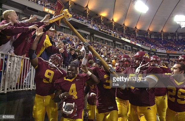 Minnesota players run around the field after they beat Wisconsin 4231 to reclaim Paul Bunyan's Axe at the Hubert H Humphrey Metrodome in Minneapolis...