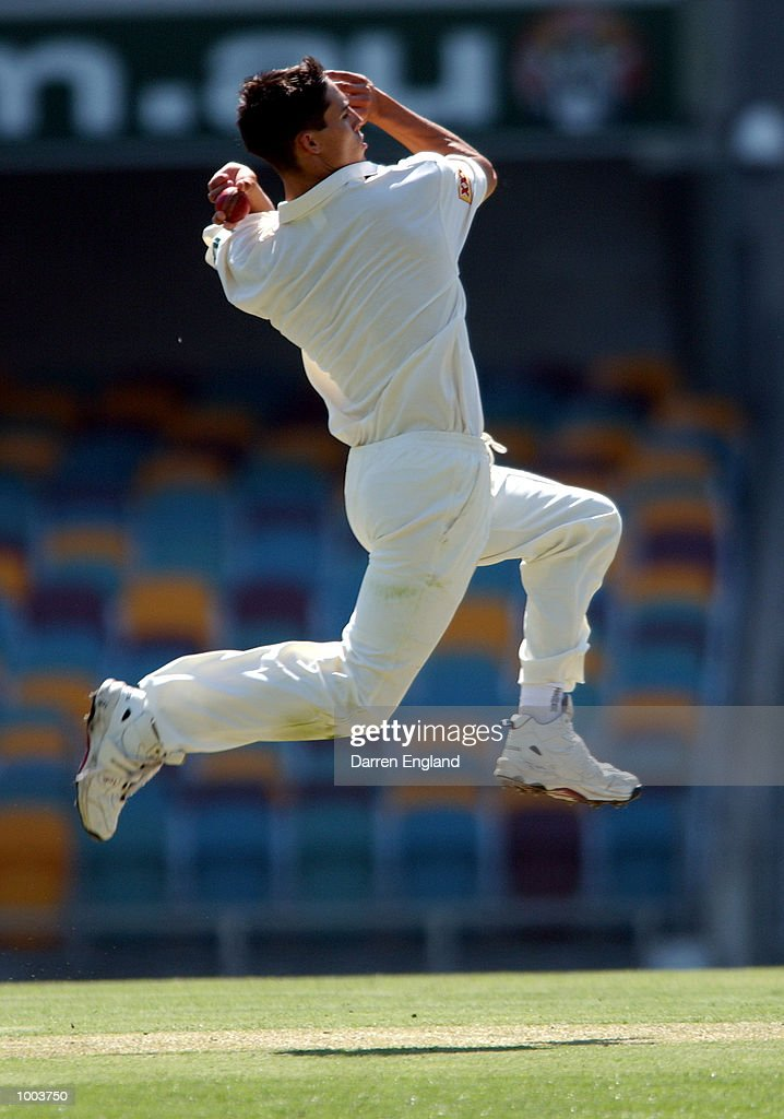 Mitchell Johnson of Queensland in action bowling against New Zealand during the New Zealand cricket teams tour match against Queensland played at the Gabba in Brisbane, Australia. DIGITAL IMAGE. Mandatory Credit: Darren England/ALLSPORT