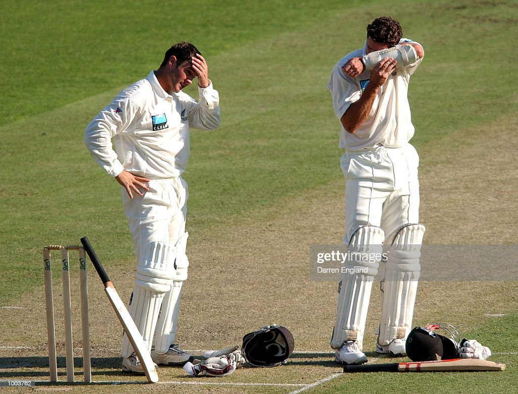 Nathan Astle and Chris Cairns of New Zealand feel the heat during the New Zealand cricket teams tour match against Queensland played at the Gabba in Brisbane, Australia. DIGITAL IMAGE. Mandatory Credit: Darren England/ALLSPORT