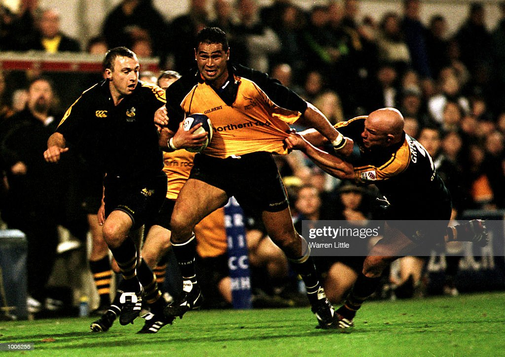 Newcastle captain Pat Lam hands off Phil Greening of Wasps during the Zurich Premiership match between London Wasps and Newcastle Falcons at Loftus Road, London. Mandatory Credit: Warren Little/ALLSPORT