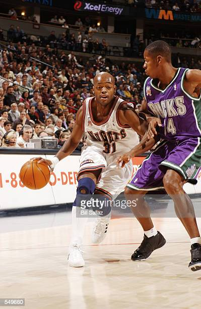 Nick Van Exel of the Denver Nuggets drives the ball around Ray Allen of the Milwaukee Bucks during their game at Pepsi Center in Denver CO The Bucks...