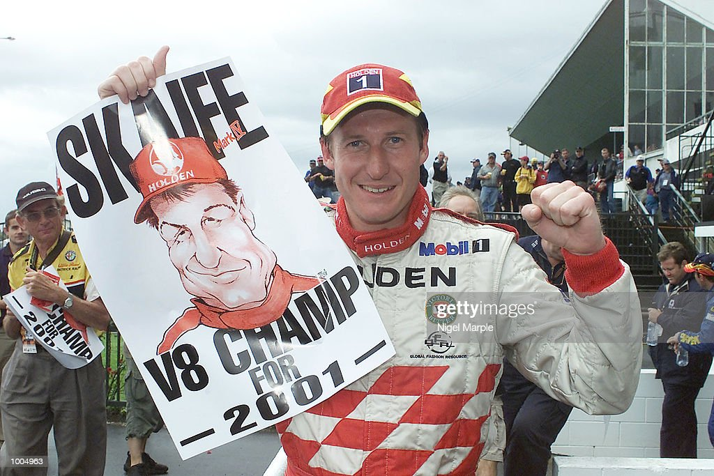 Overall championship winner Mark Skaife holds up a poster celebrating his victory after the first race of Round 12 Shell Championship at Pukekohe Park Raceway, south of Auckland, New Zealand. Mark Larkham was awarded the race ahead of GregMurphy after a red flag decision which took the race back a lap to give Larkham the win, but Skaife's 4th place was enought to give him the title. Mandatory Credit: Nigel Marple/ALLSPORT