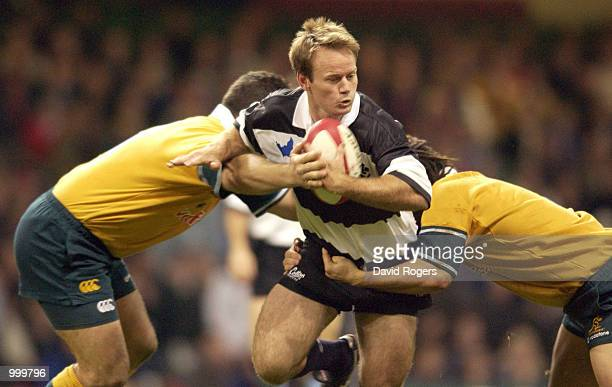 Pat Howard of the Barbarians breaks through the Australian defence during the Scottish Amicable Challenge match between the Barbarians and Australia...