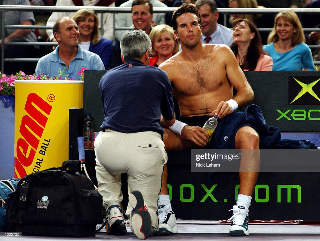 Patrick Rafter of Australia receives treatment during his match against Sabastien Grosjean of France during the Tennis Masters Cup held at the Sydney Superdome, Sydney, Australia. DIGITAL IMAGE Mandatory Credit: Nick Laham/ALLSPORT