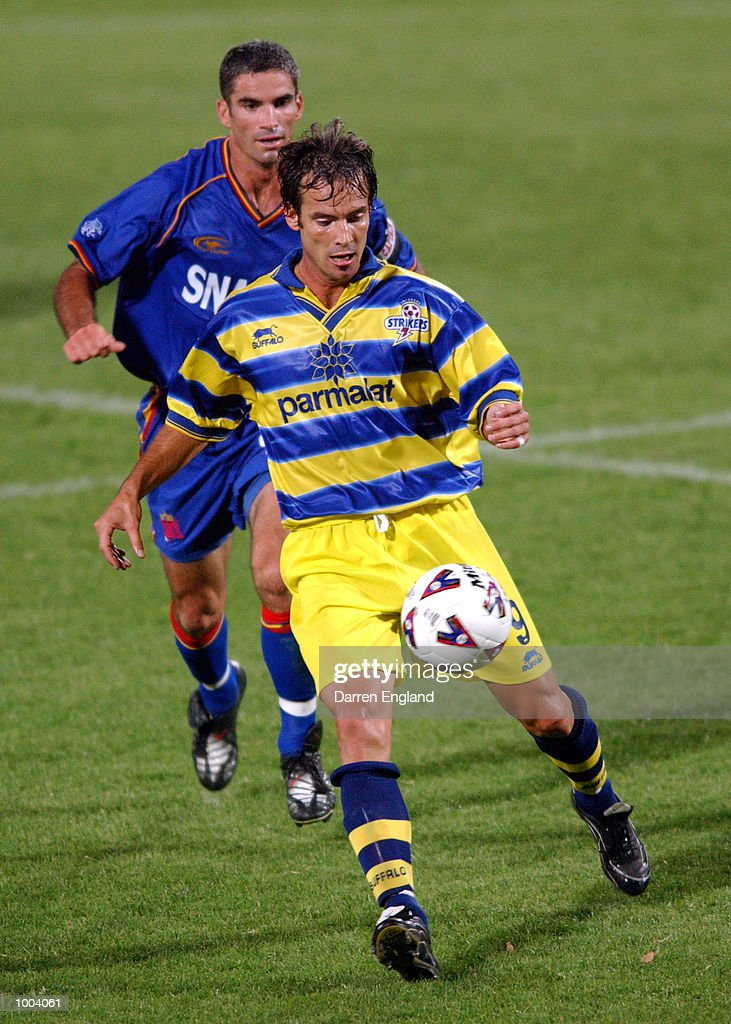 Paul Foster #9 of the Strikers gets past the tackle of Craig Foster #8 of the Spirit during the NSL round 5 match between the Brisbane Strikers and the Northern Spirit played at Ballymore in Brisbane, Australia. DIGITAL IMAGE. Mandatory Credit: Darren England/ALLSPORT
