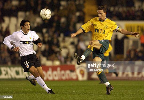 Paul Lambert of Celtic wins the ball from Vicente of Valencia during the UEFA Cup Third round first leg match between Valencia and Celtic at Stadio...