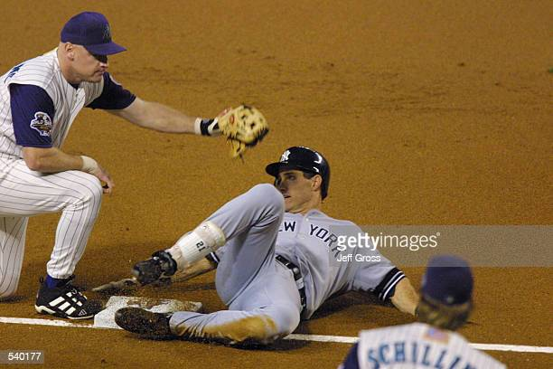Paul O''Neill of the New York Yankees is tagged out at third base by Matt Williams of the Arizona Diamondbacks as O''Neill tried to stretch a double...