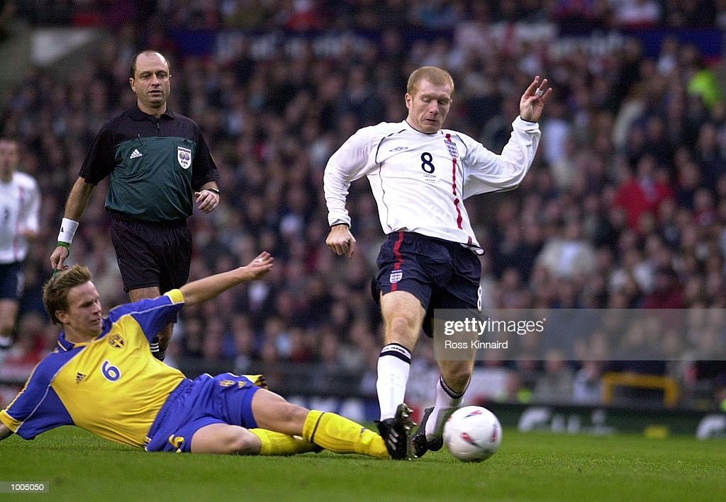 Paul Scholes of England battles with Tobias Linderoth of Sweden during the England v Sweden International friendly at Old Trafford, Manchester. DIGITAL IMAGE Mandatory Credit: Ross Kinnaird/ALLSPORT
