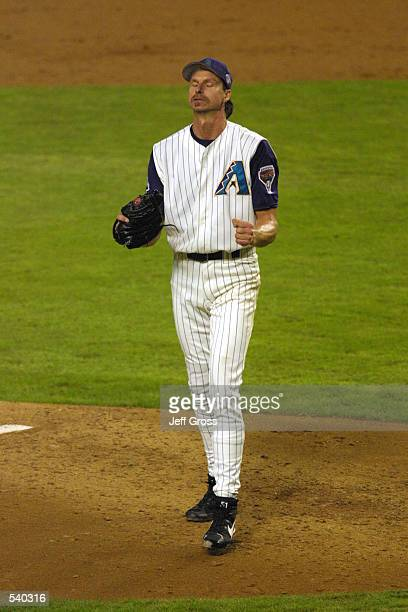 Pitcher Randy Johnson of the Arizona Diamondbacks reacts during game 6 of the World Series against the New York Yankees at Bank One Ballpark in...
