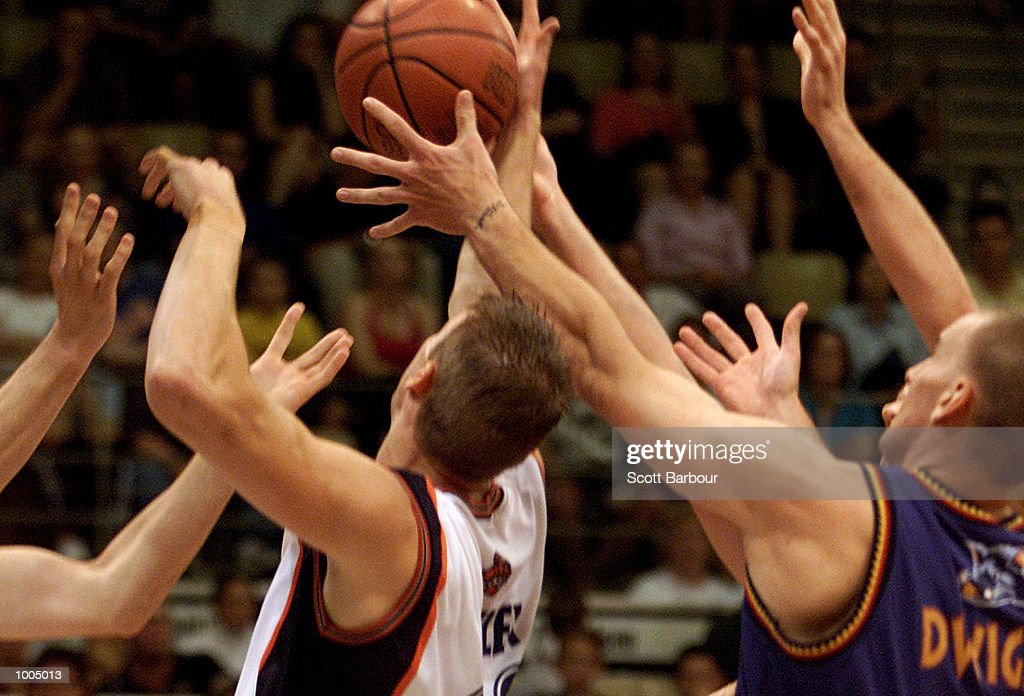 Players compete for the ball during the NBL match between the West Sydney Razorbacks and the Cairns Taipans held at the State Sports Centre in Sydney, Australia. DIGITAL IMAGE. Mandatory Credit: Scott Barbour/ALLSPORT