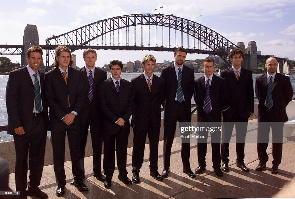 Players pose in front of the Sydney Harbour bridge (L to R) Patrick Rafter of Australia, Tommy Hass of Germany, Yevgeny Kafelnikov of Russia, Sebastien Grosjean of France, Juan Carlos Ferrero of Spain, Goran Ivanisevic of Croatia, Lleyton Hewitt of Australia, Gustavo Kuerten of Brazil and Andre Agassi of USA before a media conference in preparation for the Tennis Masters Cup in Sydney, Australia. DIGITAL IMAGE. Mandatory Credit: Scott Barbour/ALLSPORT