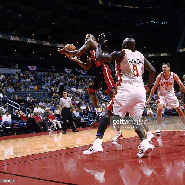Point guard Anthony Carter of the Miami Heat tries to shoot over guard Dion Glover of the Atlanta Hawks for a rebound during the NBA game at Phillips...