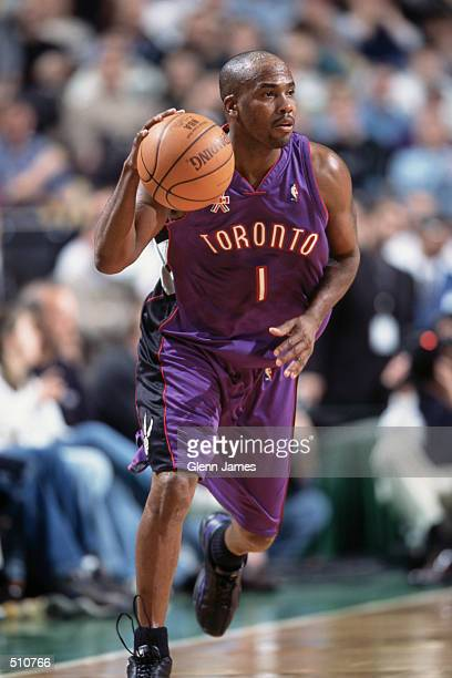 Point guard Chris Childs of the Toronto Raptors dribbles the ball during the NBA game against the Boston Celtics during at the FleetCenter in Boston...