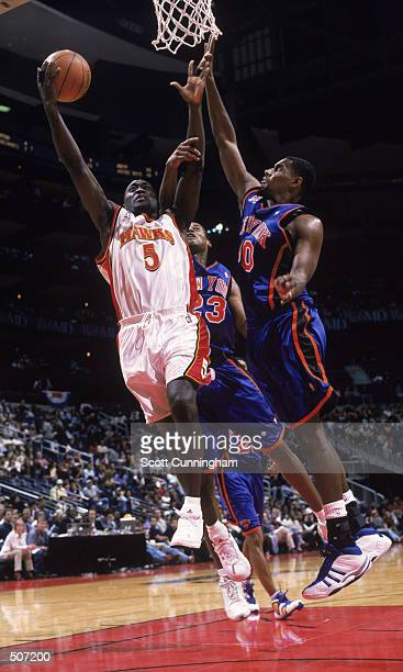 Point guard Dion Glover of the Atlanta Hawks shoots over forward Kurt Thomas of the New York Knicks during the NBA game at Phillips Arena in Atlanta...