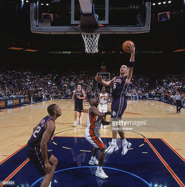 Point guard Jason Kidd of the New Jersey Nets shoots a layup during the NBA game against the Golden State Warriors at the Arena in Oakland in Oakland...