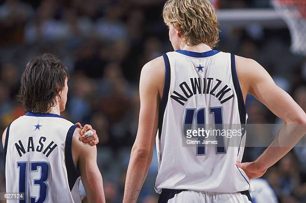 Point guard Steve Nash of the Dallas Mavericks talks to forward Dirk Nowitzki during the NBA game against the Phoenix Suns at American Airlines...