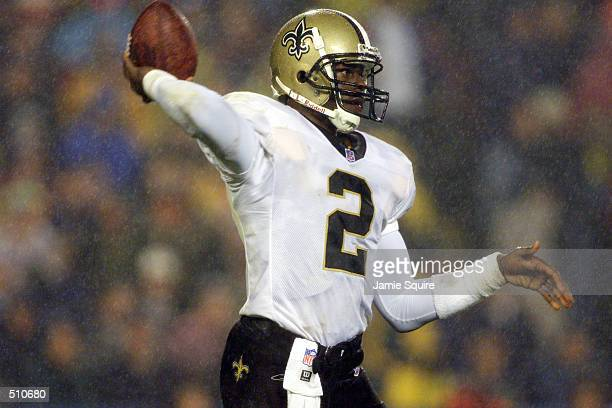Quarterback Aaron Brooks of the New Orleans Saints winds up to throw a pass during the game against the New England Patriots at Foxboro Stadium in...