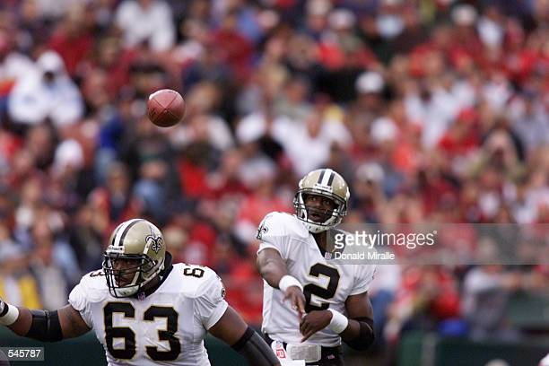 Quarterback Aaron Brooks the New Orleans Saints throws behind the blocking of teammate Wally Williams during the game against the San Fransisco 49ers...