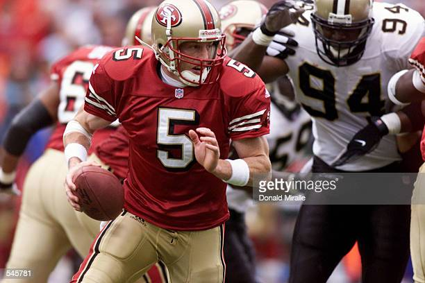 Quarterback Jeff Garcia of the San Fransisco 49ers drops back to throw against the defense of the New Orleans Saints during the game at 3 Com Stadium...