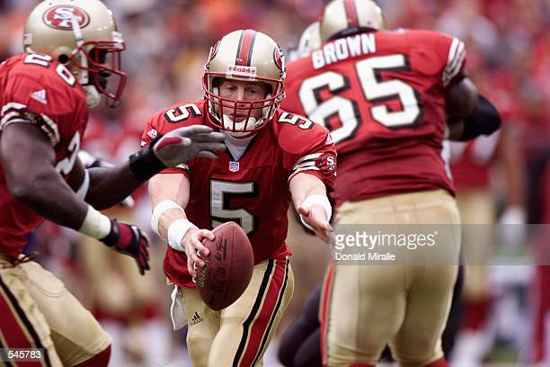 Quarterback Jeff Garcia of the San Fransisco 49ers drops back to handoff to terammate Garrison Hearst during the game against the New Orleans Saints...