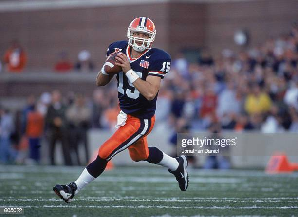 Quarterback Kurt Kittner of the Illinois Fighting Illini runs out of the pocket looking for someone to throw the ball to during the game against the...
