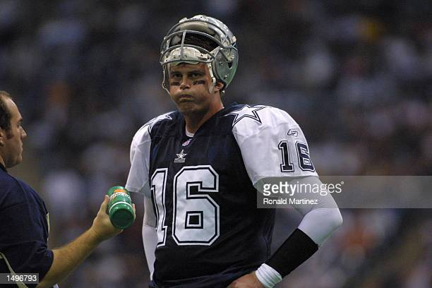 Quarterback Ryan Leaf of the Dallas Cowboys rests on the sideline during the game against the Denver Broncos at Texas Stadium in Irving Texas The...