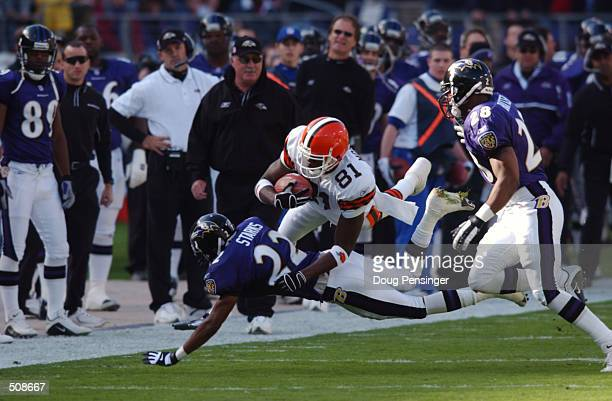 Quincy Morgan of the Cleveland Browns leaps over Duane Starks of the Baltimore Ravens during the game at PSINet Stadium in Baltimore Maryland The...