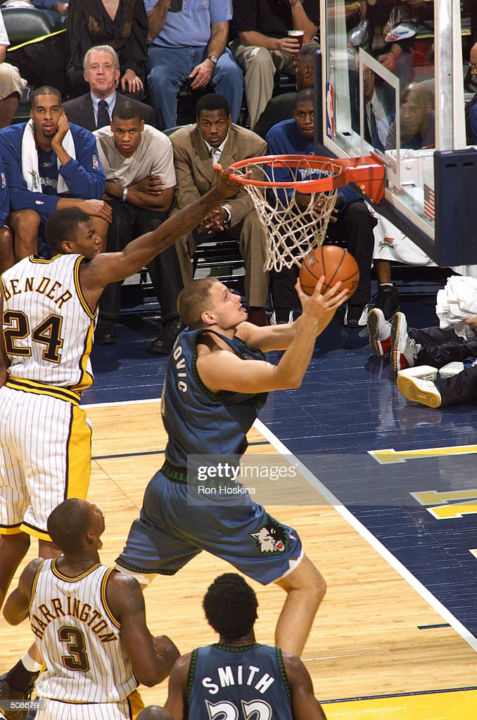 Radoslav Nesterovic #8 of the Minnesota Timberwolves goes to the basket against Jonathan Bender #24 of the Indiana Pacers during their game at Conseco Fieldhouse in Indianapolis, IN. The Timberwolves won in overtime, 120-113. Mandatory Credit: Ron Hoskins/NBAE/Getty Images Digital Image
