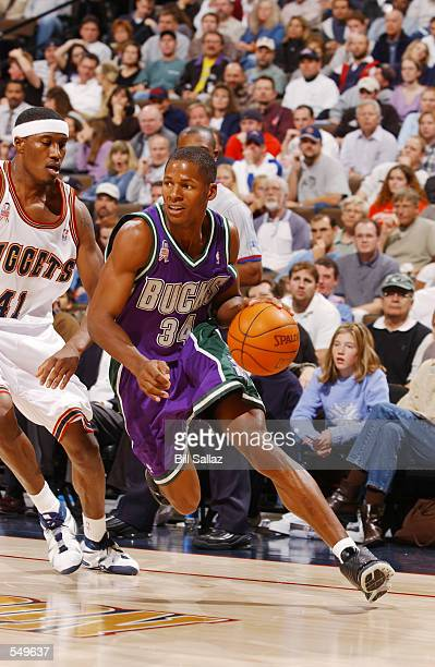 Ray Allen of the Milwaukee Bucks drives the ball around James Posey of the Denver Nuggets during their game at Pepsi Center in Denver CO The Bucks...