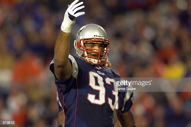Richard Seymour of the New Engand Patriots gestures during the game against the New Orleans Saints at Foxboro Stadium in Foxboro Massachusettes The...