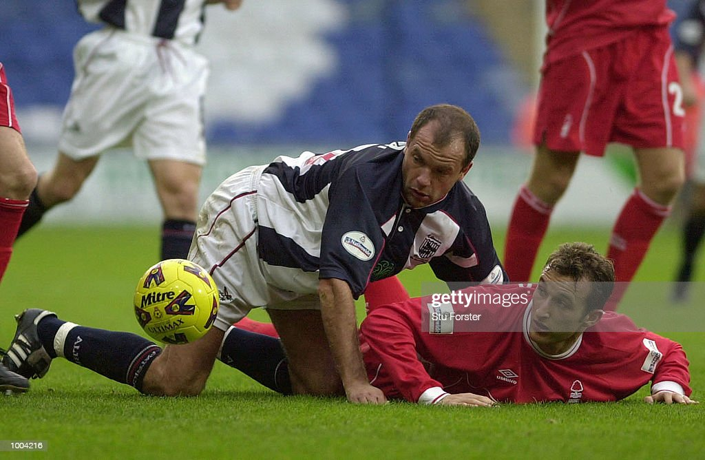 Richardo Scimeca of Nottingham Forest (right) gets entangled with Uwe Rosler of West Brom during the Nationwide League Division One match between West Bromwich Albion and Nottingham Forest at The Hawthorns, West Bromwich. DIGITAL IMAGE Mandatory Credit: Stu Forster/ALLSPORT